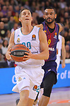 Turkish Airlines Euroleague 2017/2018.<br /> Regular Season - Round 23.<br /> FC Barcelona Lassa vs R. Madrid: 74-101.<br /> Jaycee Carroll vs Adam Hanga.