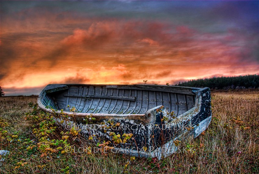 Sunset over beached fishing dory, Nova Scotia, Canada