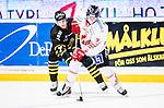 Stockholm 2015-01-04 Ishockey Hockeyallsvenskan AIK - Vita H&auml;sten :  <br /> AIK:s Ziga Pavlin i kamp om pucken med Vita H&auml;stens Anton Brehmer under matchen mellan AIK och Vita H&auml;sten <br /> (Foto: Kenta J&ouml;nsson) Nyckelord:  AIK Gnaget Hockeyallsvenskan Allsvenskan Hovet Johanneshov Isstadion Vita H&auml;sten