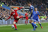 Craig Gardner of Birmingham City is closely marked by Greg Halford of Cardiff City during the Sky Bet Championship match between Cardiff City and Birmingham City at The Cardiff City Stadium, Cardiff, Wales, UK. 11 March 2017