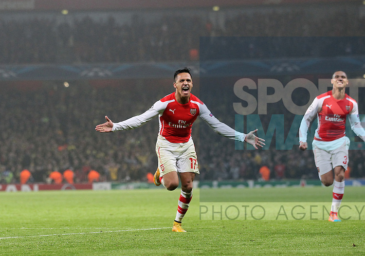 Arsenal's Alexis Sanchez celebrates scoring his sides second goal<br /> <br /> UEFA Champions League- Arsenal vs Borussia Dortmund- Emirates Stadium - England - 26th November 2014 - Picture David Klein/Sportimage