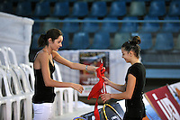 (L-R) Anna Bessonova coaches Tetyana Zahorodnya of Ukraine during light moment on training day at 2010 Holon Grand Prix at Holon, Israel on September 2, 2010.  (Photo by Tom Theobald).