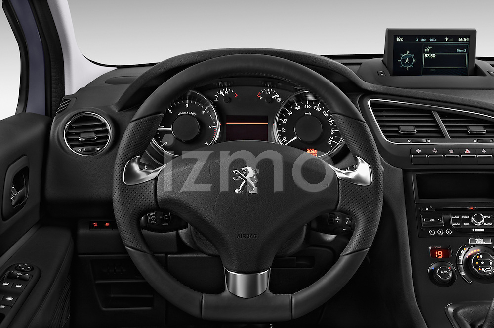 Steering wheel view of a 2014 Peugeot 5008 Allure 5 Door Mini Mpv 2WD.