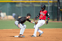 Frandy De La Rosa (4) of the Hickory Crawdads is tagged out at second base by Delmarva Shorebirds shortstop Ryan Mountcastle (4) at L.P. Frans Stadium on June 18, 2016 in Hickory, North Carolina.  The Crawdads defeated the Shorebirds 1-0 in game one of a double-header.  (Brian Westerholt/Four Seam Images)