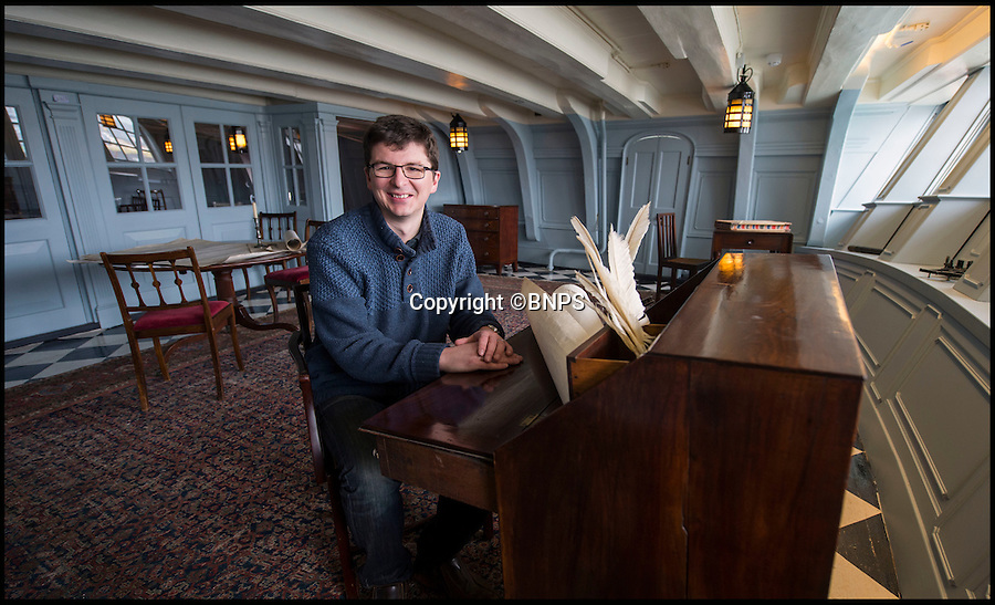 BNPS.co.uk (01202 558833)<br /> Pic: PhilYeomans/BNPS<br /> <br /> Curator Andrew Baines in Nelson's 'light and airy' day cabin.<br /> <br /> Shiver me timbers - HMS Victory get's a dramatic makeover...its baby blue paint, a lovely new Axminster carpet, and a futon for Nelson.<br /> <br /> Admiral Lord Nelson's famous flagship has undergone a remarkable makeover that includes baby blue painted walls and a futon bed, after historians researched exactly how it looked at Trafalgar.<br /> <br /> Gone is the heavily varnished timber and Victorian wooden furniture that made the Great Cabin a dark and dingy place.<br /> <br /> Instead conservationists have adopted a less-is-more approach to interior design and the place where Britain's most famous sailor slept, ate and relaxed has become a more light and airy space.