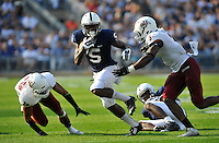 20 September 2014:  Penn State WR DaeSean Hamilton (5) runs from UMass LB Kassan Messiah (3)  . The Penn State Nittany Lions vs. the University of Massachusetts Minutemen at Beaver Stadium in State College, PA.