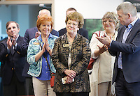 NWA Democrat-Gazette/DAVID GOTTSCHALK  Jane English (center), state senator district 34, receives an applause Wednesday, March 23, 2016, for her participation in bringing Bekaert to Rogers as she stands in the manufacturing plant. The company announced a $32 million expansion and the creation of an additional 100 new jobs.