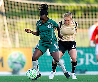 St Louis Athletica forward Enoila Aluko (9) handles the ball in front of FC Gold Pride defender Rachel Buehler (4) during a WPS match at Korte Stadium, in St. Louis, MO, May 9 2009.  St. Louis Athletica won the match 1-0.