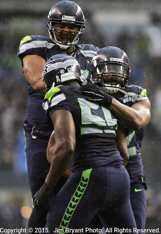 Seattle Seahawks defensive end Michael Bennett (72) celebrates his sack of York Giants quarterback Eli Manning (10) with defensive end Cliff Avril (56) at CenturyLink Field in Seattle, Washington on November 9, 2014. The Seahawks  beat the Giants 38-17.  ©2014. Jim Bryant Photo. All rights Reserved.