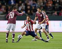 CARSON, CA – MARCH 26: Chivas USA midfielder Nick LaBrocca (10) and Colorado Rapids midfielder Pablo Mastroeni (25) during the match between Chivas USA and Colorado Rapids at the Home Depot Center, March 26, 2011 in Carson, California. Final score Chivas USA 0, Colorado Rapids 1.
