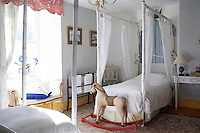 Rocking horse at foot of bed in children's bedroom, Loughcrew House, County Meath, Ireland