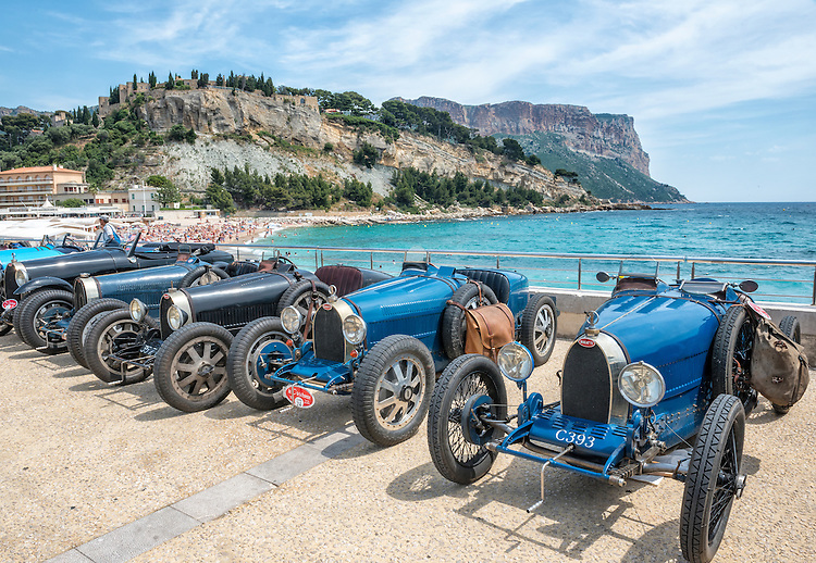 Antique Bugattis gathered from 17 countries are parked near the beach at Cassis, France, during a week-long Bugatti festival in Provence.