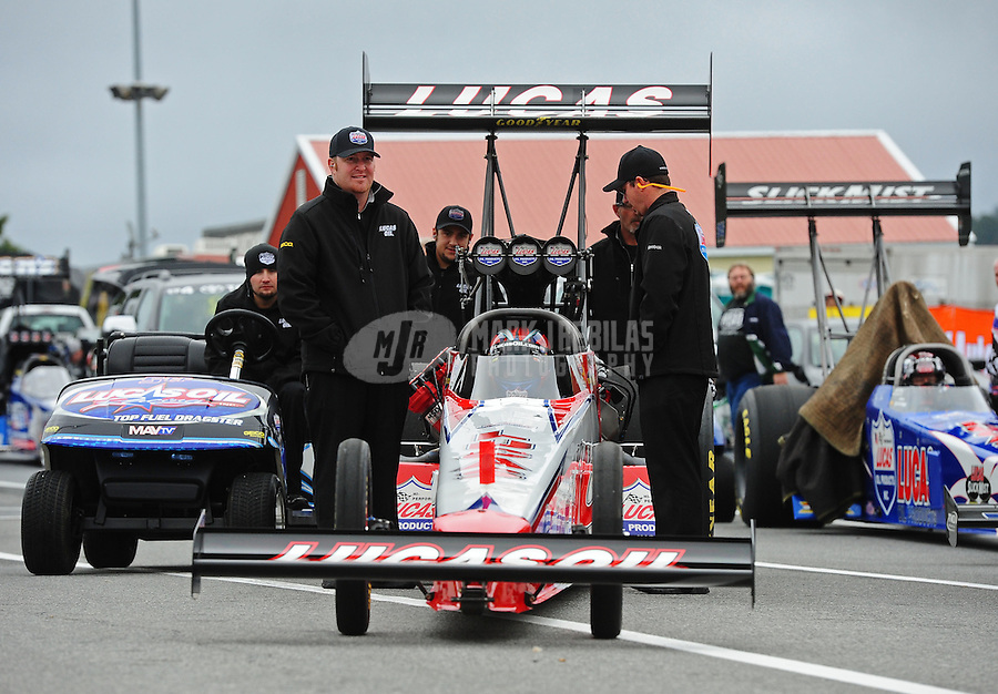 Oct. 2, 2011; Mohnton, PA, USA: NHRA top fuel dragster driver Shawn Langdon with crew members during the Auto Plus Nationals at Maple Grove Raceway. Mandatory Credit: Mark J. Rebilas-