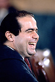 Judge Anthony Scalia of the United States Court of Appeals for the District of Columbia Circuit, enjoys a light moment during an exchange with US Senator Howard Metzenbaum (Democrat of Ohio) as he testifies before the US Senate Judiciary Committee on his nomination by US President Ronald Reagan to be Associate Justice of the Supreme Court of the United States in Washington, DC on August 5, 1986.<br /> Credit: Arnie Sachs / CNP