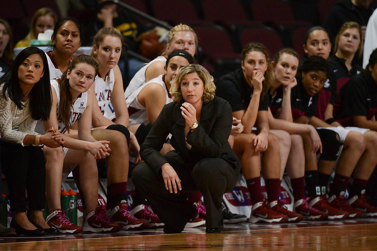 March 6, 2014; Las Vegas, NV, USA; Santa Clara Broncos head coach Jennifer Mountain watches in front of her bench against the Pepperdine Waves during the second half of the WCC Basketball Championships at Orleans Arena. The Waves defeated the Broncos 80-74.