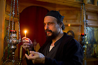 Mount Athos - The Holy Mountain.<br /> Father Iusif prays inside his church.<br /> <br /> Photographer: Rick Findler