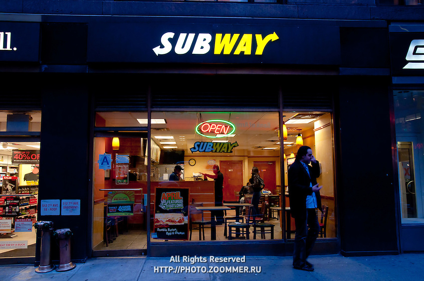 Fast food Subway restaurant in New York City at night