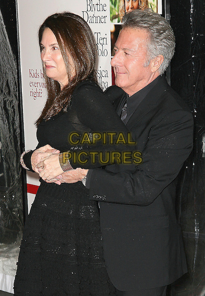 LISA GOTTSEGEN & DUSTIN HOFFMAN .At the world film premiere of 'Little Fockers' at Ziegfeld Theatre in New York City, New York, NY, USA, 15th December 2010..half length black married husband wife arms around side dress suit jacket .CAP/ADM/PZ.©Paul Zimmerman/AdMedia/Capital Pictures.