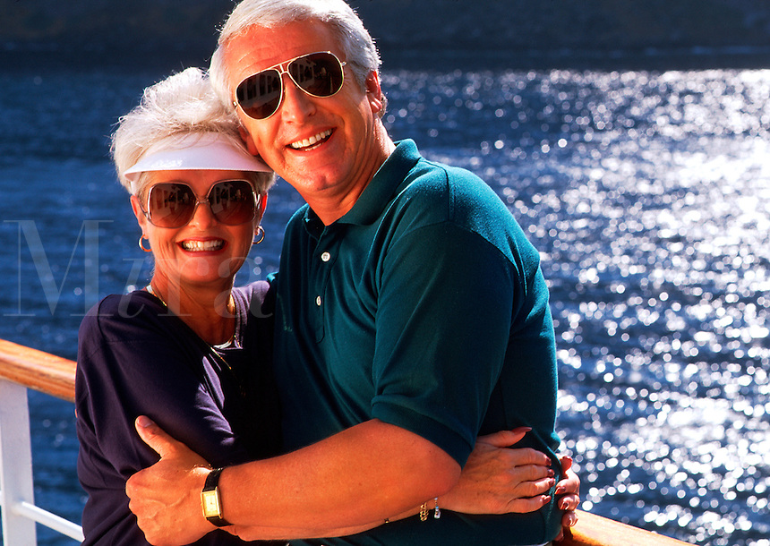 Romantic, retired couple on deck of cruise ship