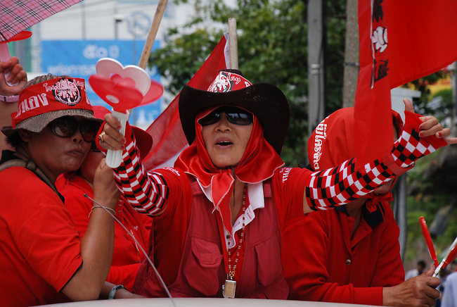 BANGKOK MARCH 20: Red Shirt protestors parade down Petchburi Road during an anti-government rally on March 20, 2010, Bangkok, Thailand.