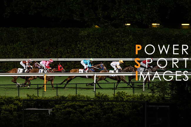 Jockey Joao Moreira riding Regency Honey (R) leading the race 2 during Hong Kong Racing at Happy Valley Racecourse on September 13, 2017 in Hong Kong, China. Photo by Marcio Rodrigo Machado / Power Sport Images