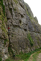 Climbers scaling cliffs in Cheddar Gorge, Cheddar, UK, October 16, 2017. Spectacular Cheddar Gorge features the highest inland cliffs in the UK. The nearby village of Cheddar is also the birthplace of the eponymous cheese.
