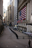 New York, New York<br /> March 18, 2020<br /> 8:35 AM<br /> <br /> Manhattan under coronavirus pandemic. <br /> <br /> The New York Stock Exchange and Wall Street void of people as the market falls over 10,000 points following weeks of the economic fear as a result of the virus.