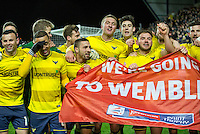 It is too much for Kemar Roofe (2nd left) of Oxford United whose 2 goals put his side into the Wembley final during the Johnstone's Paint Trophy Southern Final 2nd Leg match between Oxford United and Millwall at the Kassam Stadium, Oxford, England on 2 February 2016. Photo by Andy Rowland / PRiME Media Images.