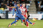 Getafe's Wanderson (l) and Atletico de Madrid's Saul Niguez during La Liga match. February 14,2016. (ALTERPHOTOS/Acero)