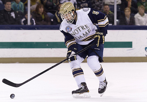 November 02, 2012:  Notre Dame defenseman Robbie Russo (#5) skates with the puck during NCAA Hockey game action between the Notre Dame Fighting Irish and the Western Michigan Broncos at Compton Family Ice Arena in South Bend, Indiana.  Western Michigan defeated Notre Dame 3-2.