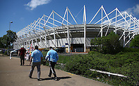 Fans make their way to the Liberty Stadium before the Barclays Premier League match between Swansea City and Manchester City played at The Liberty Stadium, Swansea on 15th May 2016