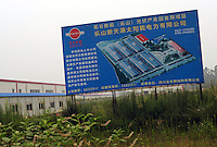 An advert for a new solar factory in Leshan City High Tech Development Zone also known as Photovoltaic Industry Park, Sichuan, China. The park houses several plants dedicated to plysilicon production.  Leshan is known as China's polysilicon Capitol due to thr number of new plants in the region and the Governments willingness to attract investment into the polysilicon industry.<br /><br />photo by Richard Jones/Sinopix