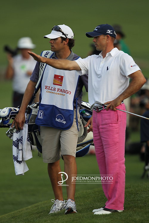 May 8,2011 - Jonathan Byrd and his caddy discuss tactics after his playoff shot lands on the wrong side of the green at 18.  Lucas Glover wins the tournament in sudden death over Jonathan Byrd at Quail Hollow Country Club,Charlotte,NC.