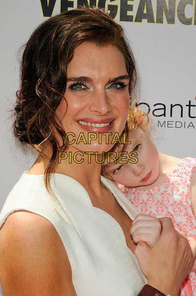 "BROOKE SHIELDS with her daughter Rowan .The Los Angeles premiere of ""Furry Vengeance"" at Mann Bruin Theatre in Westwood, California, USA..April 18th, 2010 .headshot portrait hair up earrings silver white scallop edge edged wavy trim smiling kid child mother mom mum family pink holding hands .CAP/ROT.©Lee Roth/Capital Pictures"
