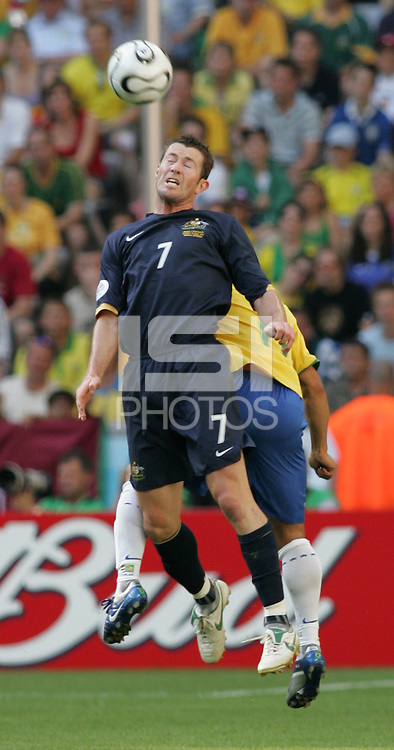 Roberto Carlos of Australia goes up for a header. Brazil defeated Australia, 2-0, in their FIFA World Cup Group F match at the FIFA World Cup Stadium, Munich, Germany, June 18, 2006.