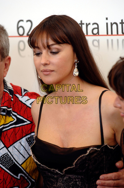 "MONICA BELLUCCI.photocall for ""The Bothers Grimm"".62nd International Film Festival,.Venice, 4th September 2005.portrait headshot La Biennale black corset strappy lace top diamnond dimante earrings .Ref: PL.www.capitalpictures.com.sales@capitalpictures.com.©Capital Pictures."