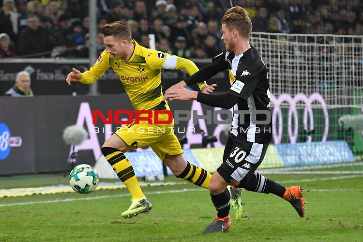 18.02.2018, Borussia Park, M&ouml;nchengladbach, GER, 1. FBL., Borussia M&ouml;nchengladbach vs. Borussia Dortmund<br /> <br /> im Bild / picture shows: <br /> Nico Elvedi (Gladbach #30),  re im Zweikampf gegen  Marco Reuss (Borussia Dortmund #11), <br /> <br /> Foto &copy; nordphoto / Meuter