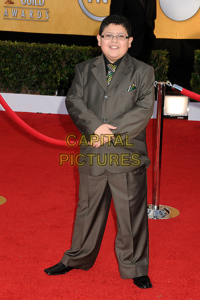 RICO RODRIGUEZ.17th Annual Screen Actors Guild Awards held at The Shrine Auditorium, Los Angeles, California, USA..January 30th, 2011.SAG arrivals full length suit black grey gray glasses stripe tie .CAP/ADM/BP.©Byron Purvis/AdMedia/Capital Pictures.