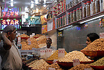 Dried fruit and nuts vendor in Old Delhi, India.