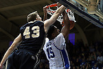 30 November 2014: Duke's Jahlil Okafor (15) dunks behind Army's Travis Rollo (43). The Duke University Blue Devils hosted the West Point Military Academy Army Black Knights at Cameron Indoor Stadium in Durham, North Carolina in a 2014-16 NCAA Men's Basketball Division I game. Duke won the game 93-73.
