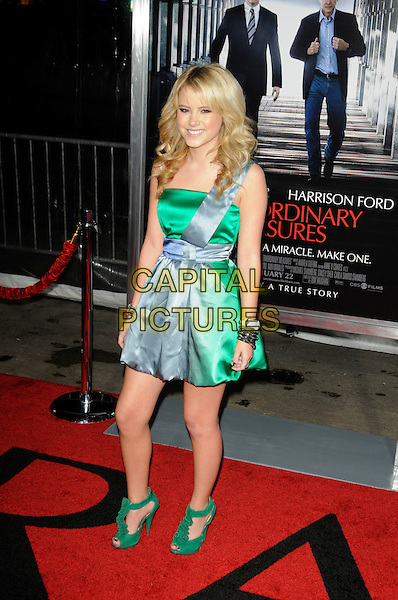 "TAYLOR SPREITLER (wearing the same dress as Deja Kreutzberg).arriving at the premiere of ""Extraordinary Measures"" at Grauman's Chinese Theatre in Hollywood, California, USA,   January 19th, 2010..arrivals full length green blue silk dress one shoulder satin colour block peep toe suede ruffle shoes sandals bracelets .CAP/ROT.©Lee Roth/Capital Pictures"