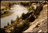 Locomotive with water car, box car, flat car, caboose. South of Durango along Animas River.<br /> D&amp;RGW  s. e. of Durango, CO