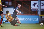 Liam Boyce fouled by Dan Seagrove for a penalty kick