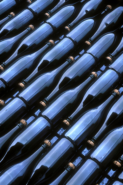 Bottles of sparkling wine await labeling in Dundee, Oregon
