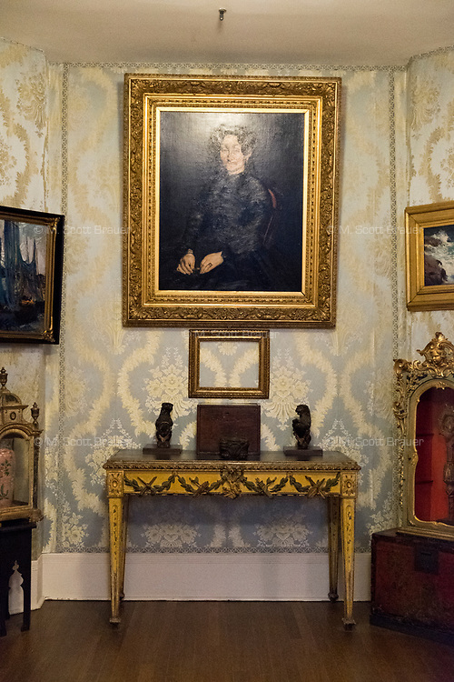 """An empty frame that once held Manet's """"Chez Tortoni"""" hangs on the wall in The Blue Room of the Isabella Stewart Gardner Museum in Boston, Mass., USA, on Tues., Dec. 5, 2017. The painting was one of 13 objects stolen in a 1990 heist. Hanging above the empty frame is Manet's portrait of his mother, """"Madame Auguste Manet."""" Paintings by Manet, Rembrandt, Vermeer, and Degas, were stolen in the theft alongside two objects and one etching."""