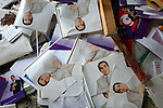 Posters of Tunisian President Zine El Abidine Ben Ali lie on the floor of the looted ruling party headquaters in Carthage suburb, Tunis, Tunisia, Jan. 16, 2011.