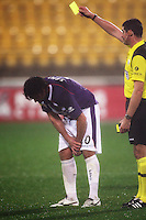 Perth's Wayne Srhoj is yellow-carded before going off injured during the A-League football match between Wellington Phoenix and Perth Glory at Westpac Stadium, Wellington, New Zealand on Sunday, 16 August 2009. Photo: Dave Lintott / lintottphoto.co.nz