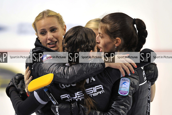 Victoria Moiseeva (Russian Federation, left) and her team celebrate their victory. Womens semi finals. Le Gruyère AOP European Curling Championships 2016. Intu Braehead Arena. Glasgow. Renfrewshire. Scotland. UK. 25/11/2016. ~ MANDATORY CREDIT Garry Bowden/Sport in Pictures - NO UNAUTHORISED USE - +447837 394578