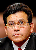 "Washington, D.C. - July 24, 2007 -- United States Attorney General Alberto Gonzales testifies before the United States Senate Judiciary Committee on ""Oversight of the United States Department of Justice"" on Capitol Hill in Washington, D.C. on Tuesday, July 24, 2007.  He took questions on his role in the firing of federal prosecutors.<br /> Credit: Ron Sachs / CNP"