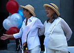 """A small crowd gathered at the State Capitol on Thursday, August 18, 2016 in Sacramento, California to celebrate the 96th anniversary of the ratification of the 19th Amendment to the United States Constitution granting women the right to vote.  Kate Van Buren, Mistress of Ceremony, introduced speakers, Gina Mulligan, author of """"Remember The Ladies"""", Angelique Ashby, Sacramento City Council, Nancy Compton, League of Women Voters, Katie McCleary, of 916 Ink and Rachel Michellin of CA Women Lead.  Singer-song writer Virginia Ayers Dawson began the event by singing the National Anthem and as a closing ceremony the group unfurled the banner for the Unity Banner For Hillary Project for a group photograph.  Photo/Victoria Sheridan 2016"""